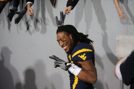 Colorful character: West Virginia's Bruce Irvin celebrates with fans following a 21-20 win against Pittsburgh during a game on Nov. 25, 2011, in Morgantown, W.Va.
