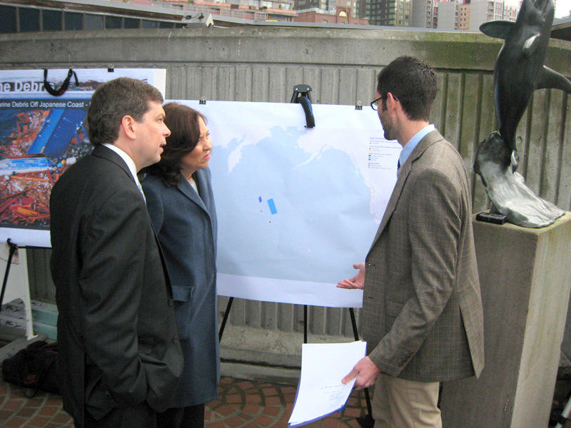 U.S. Sens. Mark Begich and Maria Cantwell talk to Peter Murphy with the marine debris program at the National Oceanic and Atmospheric Administration in Seattle in March about the way tsunami debris is expected to cross the Pacific Ocean from Japan.