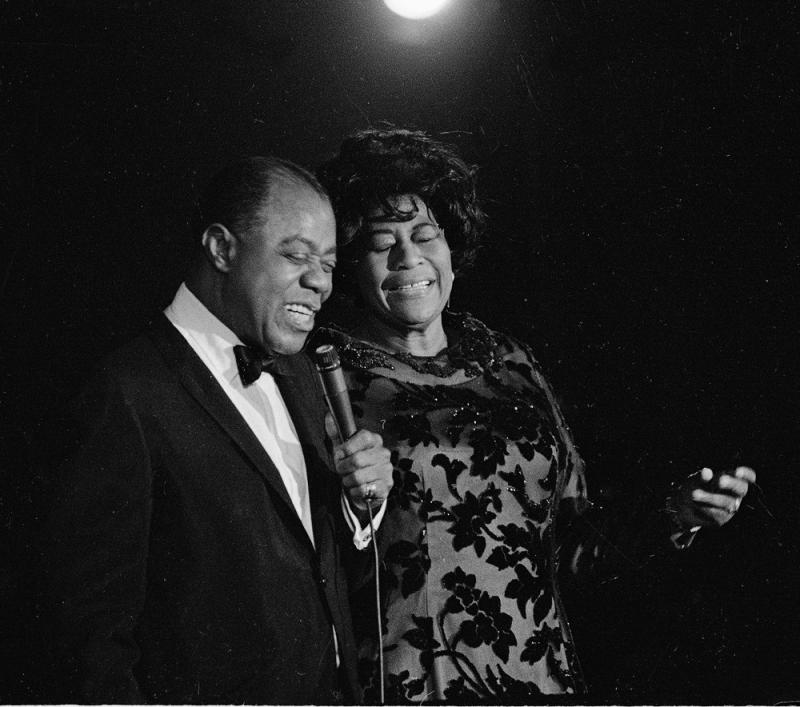 Louis Armstrong, left, makes a guest appearance as Ella Fitzgerald opens at the Empire Room of the Waldorf Astoria in New York City, March 30, 1971.
