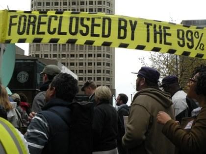 Protesters staged a mock foreclosure of Wells Fargo Bank as part of a tax day protest.