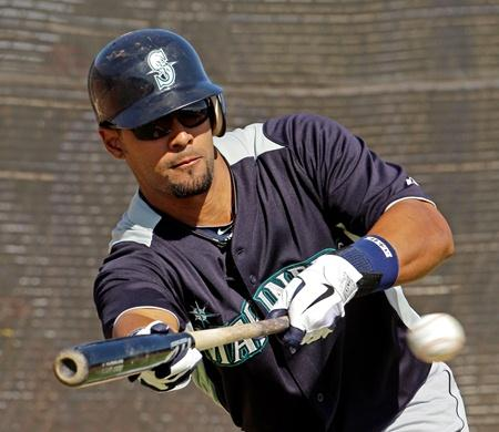 Mariners center fielder Franklin Gutierrez bunts during spring training in Arizona last month.