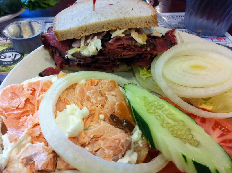 A half pastrami on rye, kippered salmon on a bagel and some pickles from Pumpernick's.