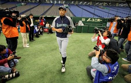 Coming Home. Japanese journalists focus their cameras on Mariner and native son Ichiro Suzuki before practice this week at the Tokyo Dome in Tokyo, Japan.