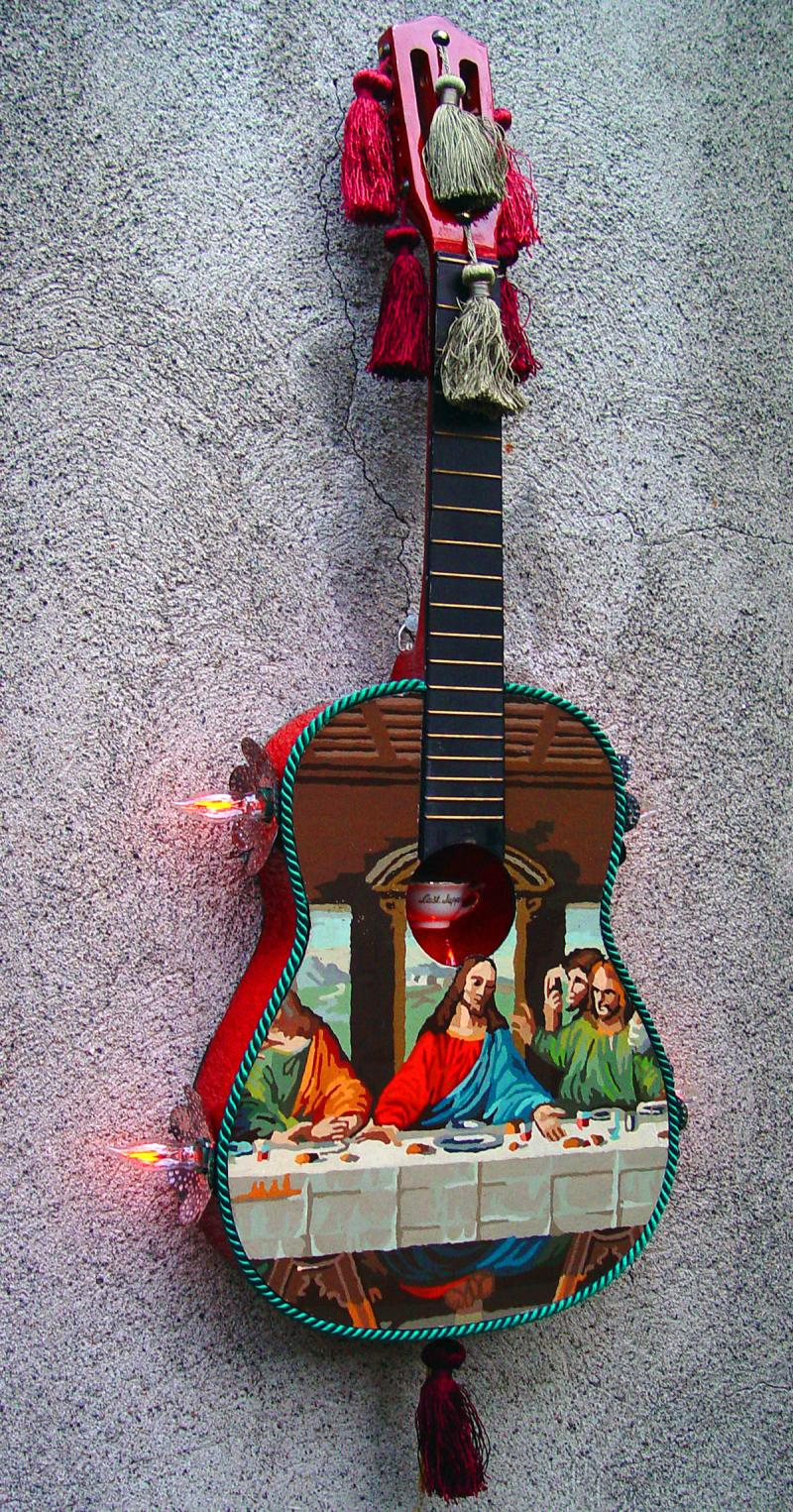 """Last Supper"" with tassles and a wee porcelain cup in the sound hole."