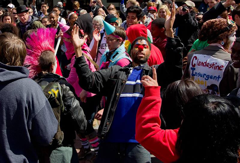"May Day demonstrators dance to music by DJ Sean Malik during ""Hip Hop Occupies"" at Westlake Park Tuesday morning."