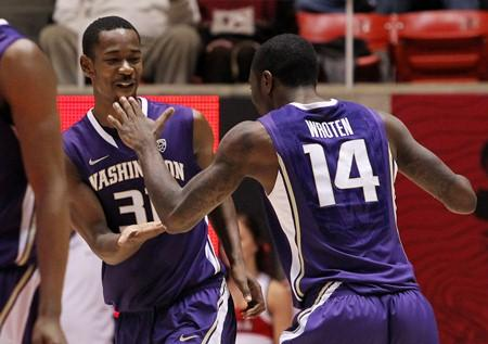 UW's Terrence Ross (31) and Tony Wroten (14) celebrate their 57-53 win over Utah on Jan. 7, 2012. Ross was the Huskies' leading scorer with 14 points.