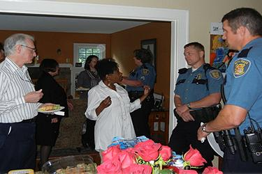 A living room conversation with Seattle police, taking place in a residential home.