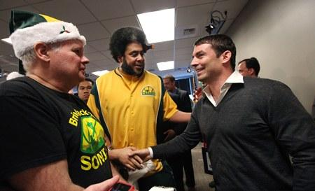 "Investor Chris Hansen, right, shakes hands with Seattle SuperSonics supporters Kris ""Sonics Guy"" Brannon, center, and David Brown on Wednesday, after a memorandum of understanding was signed in an effort to bring the NBA back to Seattle."