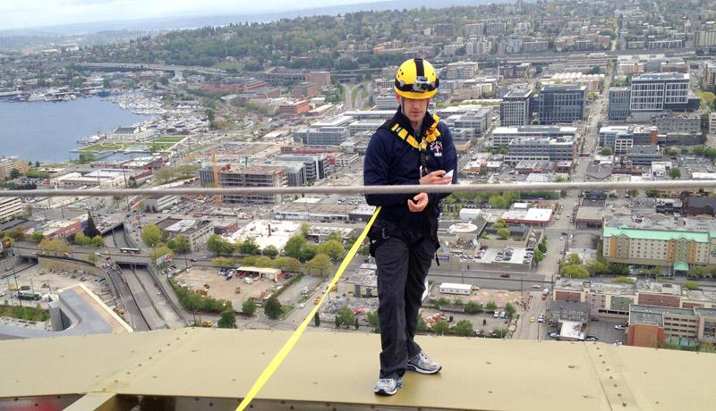 Gregory Schneider answers questions while walking the ring atop the Seattle Space Needle. Schneider won the Needle's trip into space.