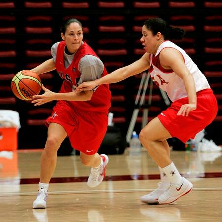 Guard Sue Bird, left, of the US Olympic women's basketball team dribbles around teammate Kara Lawson during practice in Stanford, Calif., Tuesday, July 29, 2008.