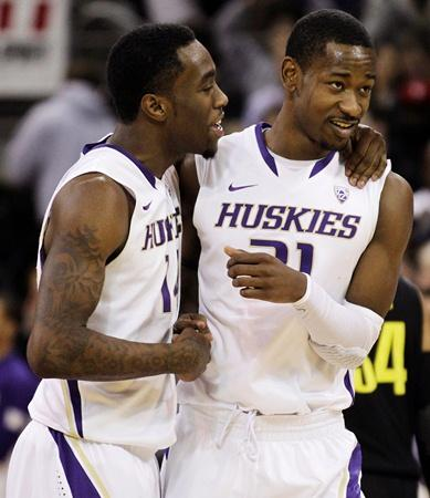 Tony Wroten, left, celebrates Washington's 90-86 win over Oregon with Terrance Ross, right, in a quarterfinal in the National Invitation Tournament March 20 in Seattle.  Both are leaving UW to enter the NBA draft.