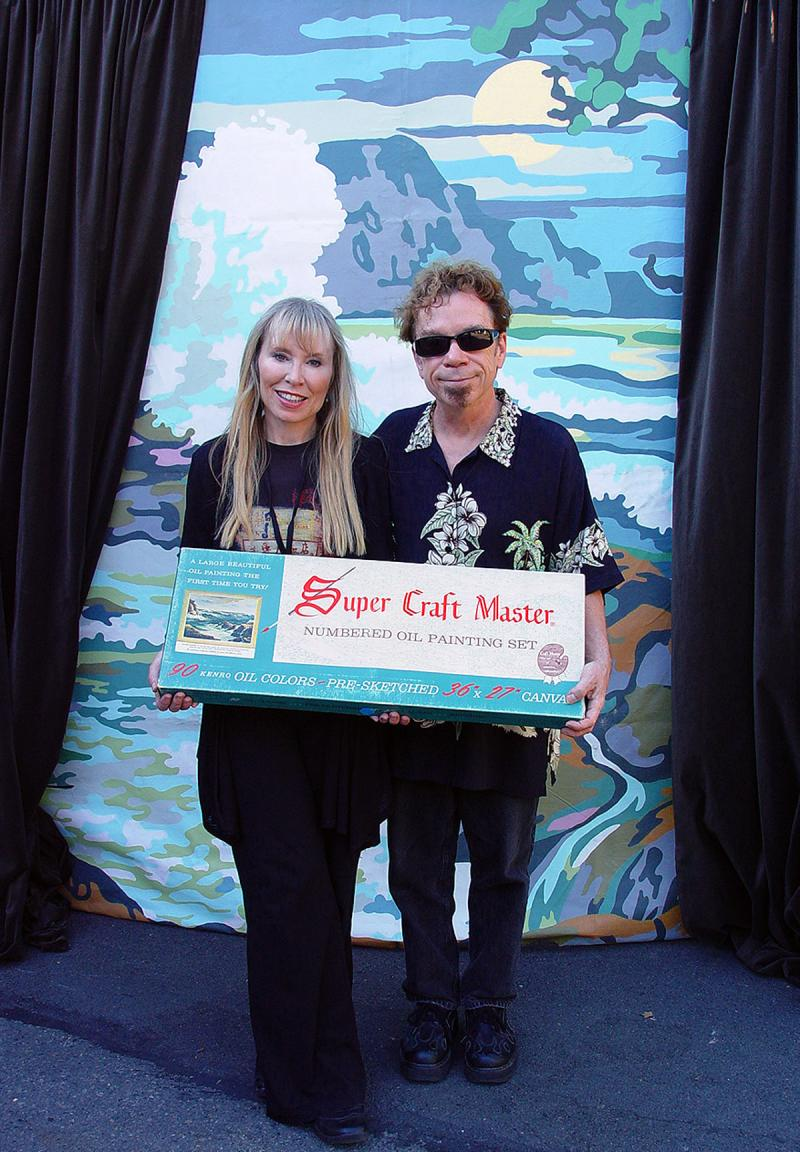 Bill Blair brought his paint-by-numbers backdrops to Bumbershoot 2011 and invited folks to pose. Pictured here are the show's curators Marlow Harris and Jo David of Seattle.