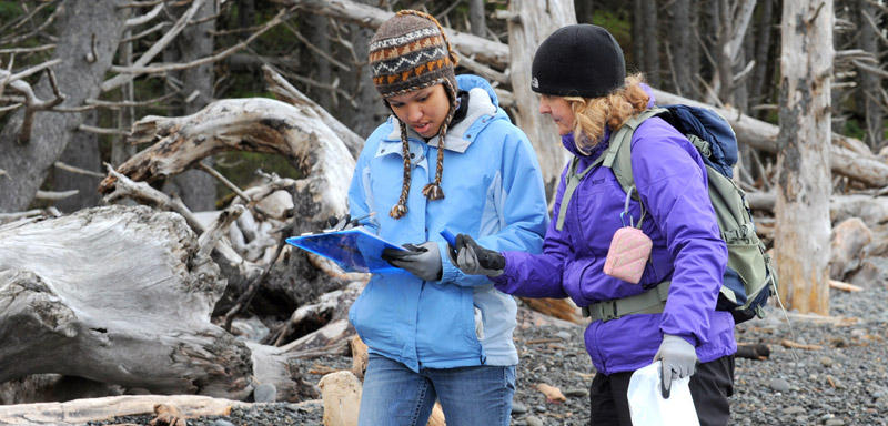 Anna Pietz and her daughter examine debris at Rialto Beach in La Push, Wash., on Saturday. The two had volunteered with Washington Coastsavers. Pietz said they did find a Japanese float believed to be from the tsunami.