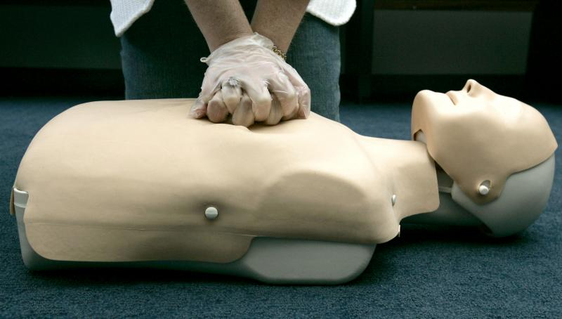 "American Red Cross ""hands-only"" CPR training, using an inflatable mannequin."