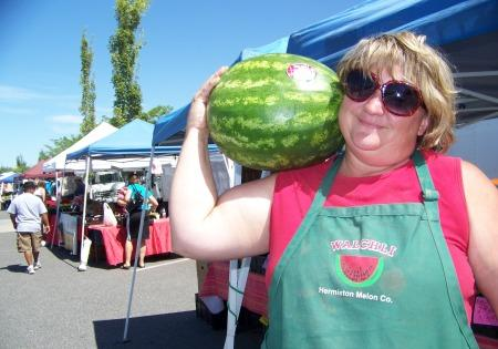 Rochelle Walchi of Hermiston, Ore. sells her family's watermelons at farmers markets across the Northwest. She regularly teaches customers how to thump melons and pick a good one.