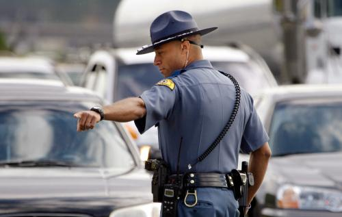 A Washington State Trooper directs traffic near the Parkland site where four Lakewood Police Officers were shot and killed in late November, 2009.
