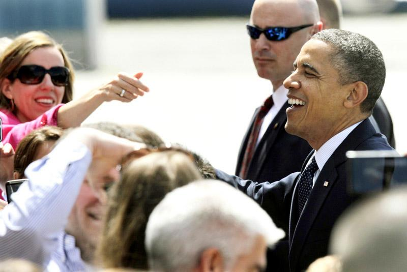 President Barack Obama greets supporters upon his arrival in Seattle, Thursday. Obama was in town for fund-raising events.