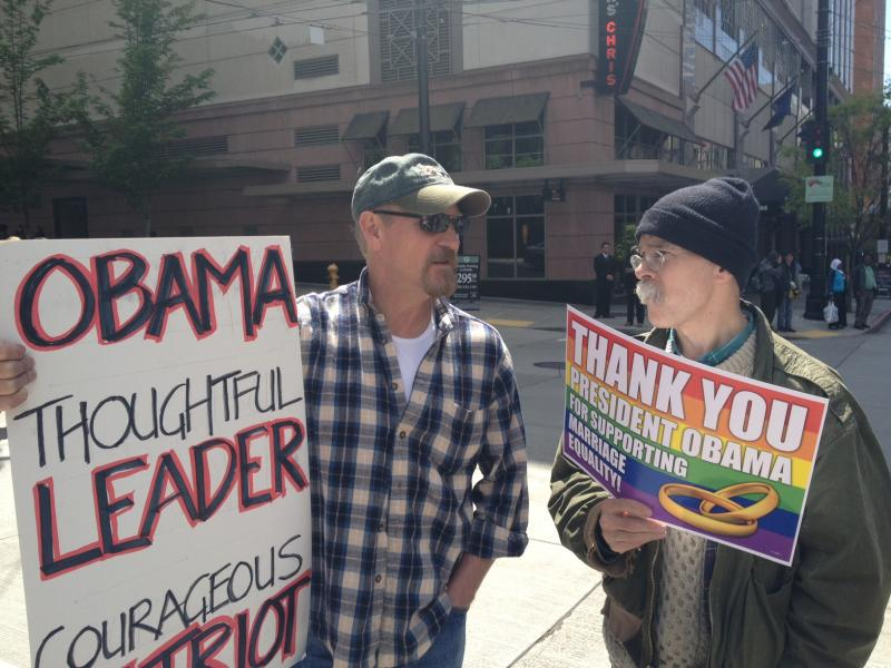 Randy Henson, (l), a long-time advocate for gay rights, says he never thought he would hear a sitting president voice support for same-sex marriage rights. He was part of a rally supporting President, outside the fundraiser at the Paramount Theater.