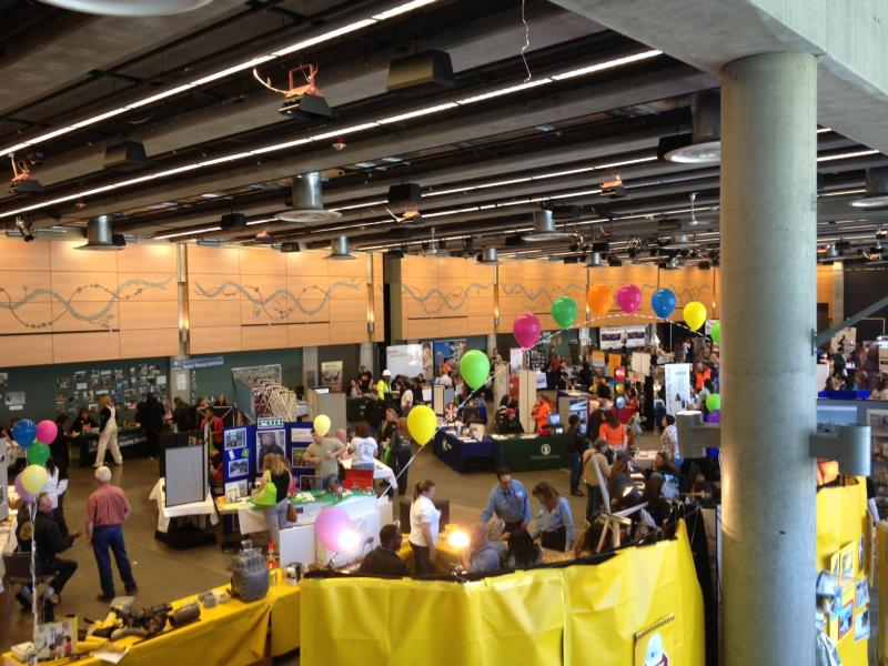 A wide shot of the 80 exhibitors at the annual Washington Women in Trades career fair at Seattle Center's Fisher Pavillion.