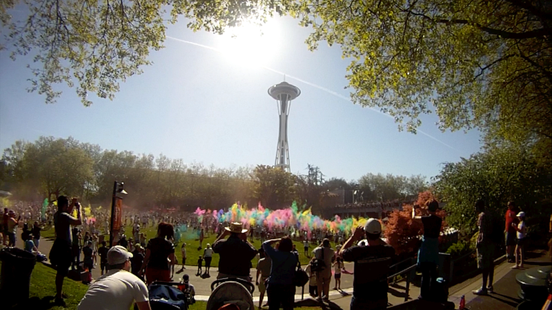 Color cloud rises in front of the Space Needle.