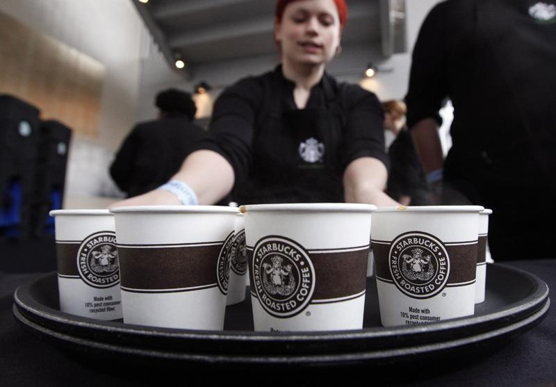 A barista prepares to serve sample-sized coffee cups before the annual Starbucks shareholders meeting in Seattle.