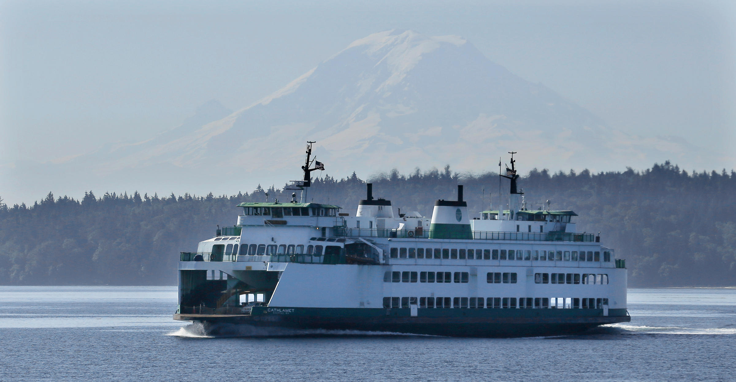 Coast guard to require more life rafts on washington ferries knkx file the washington state ferry boat cathlamet sails with mount rainier in the background wednesday july 16 2014 near seattle sciox Images