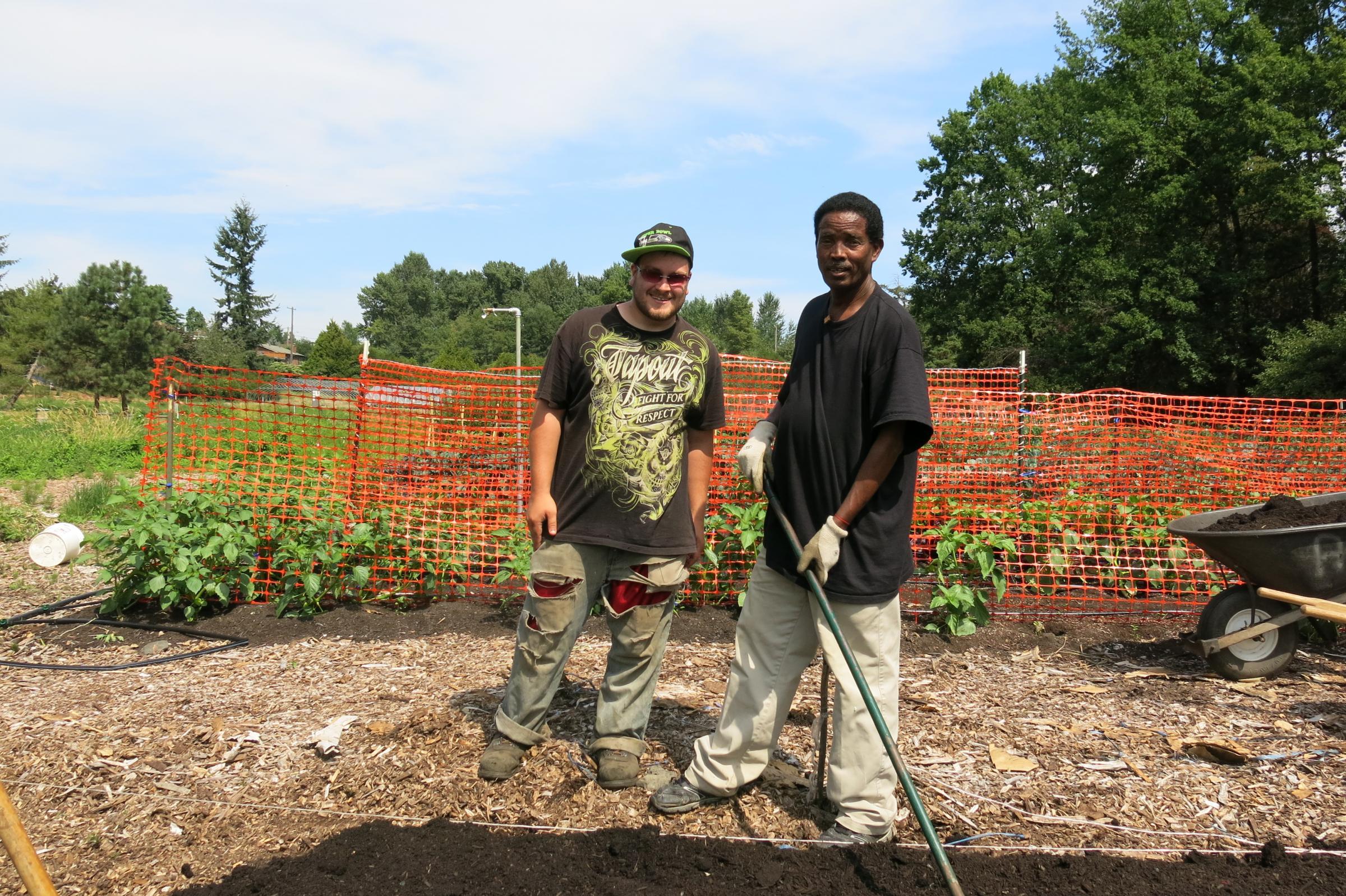 Coty Fitzgerald And Mekonene Bihon Take A Break From Raking The Soil At  Rainier Beach Urban Farm And Wetlands On Friday, Aug. 1, 2014.