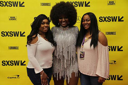 Taylor Hendrix (left) and Makalah Adams (right) of PV-U Kno Student Radio Station interview with breakout star of this season of Love & Hip Hop: Miami and Afro-Latina singer, Amara la Negra, after her stage performance