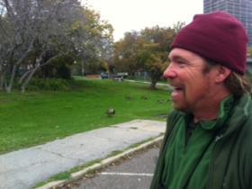 David Lukas observes a flock of unperturbed Canada geese grazing near Oakland's Lake Merritt.