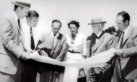 Architects Aaron Green and Frank Lloyd Wright (in hat at right), County Planning Director Mary Summers, and others, reviewing plans on the site of the future Marin County Civic Center, c. 1958