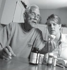 Reviewing new medications is often part of the learning process for newly discharged hospital patients, one that visiting nurses can assist with.