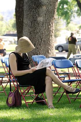 Woman reading at SRJC's Day Under the Oaks