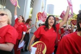 Nurses from the California Nurses Association rallied Tuesday outside Kaiser Permanente's Oakland headquarters.