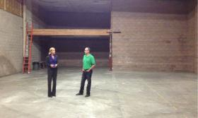 Sonoma County Museum Executive Director Diane Evans and Curator Eric Stanley survey the possibilities inside the former carpet warehouse space that will become a new art museum.