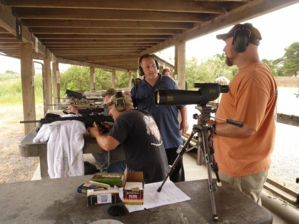 West speaks with shooters at a non-lead ammunition outreach event.
