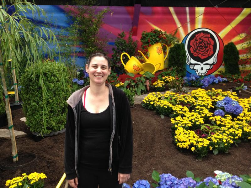 Rebecca Posey stands before her work in progress--a floral interpretation of the Grateful Dead song, Scarlet Begonias.
