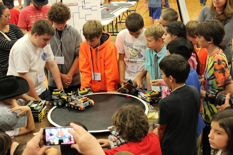 Students compete in the 'sumo' category of the Sonoma County Robotics Challenge, May 2. The object is to knock the competing robot out of the ring.