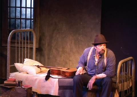 "John McCutcheon as the late labor organizer, on stage in ""Joe Hill's Last Will."""