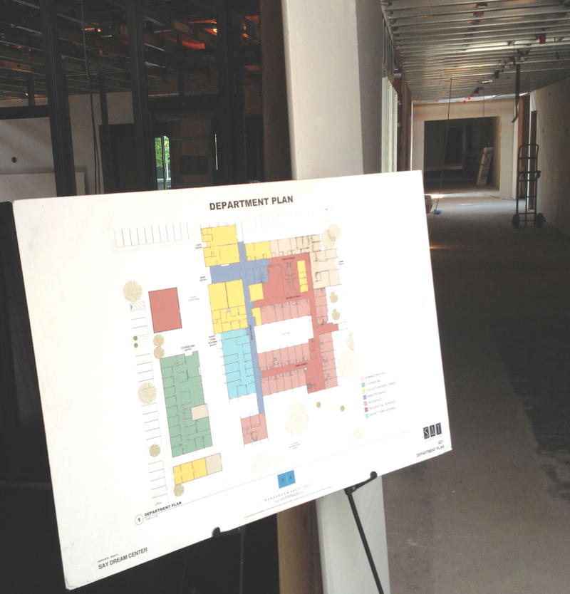 Visitors touring the work-in-progress Dream Center are greeted with a color-coded floor plan for the new facility, before heading down an unlit hallway.