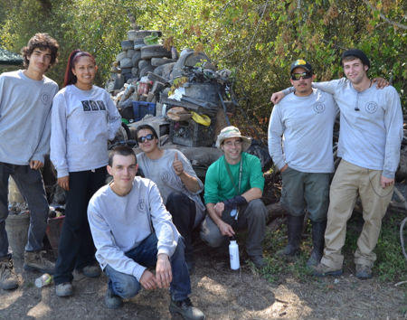 The crew from the Sononma County Youth Ecology Corps that labored to create the trash mound on display behind them