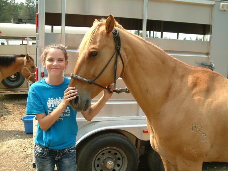 "Faith Anderson and her horse ""Dusty"". Anderson says donated bales of hay have been crucial for keeping Dusty healthy."