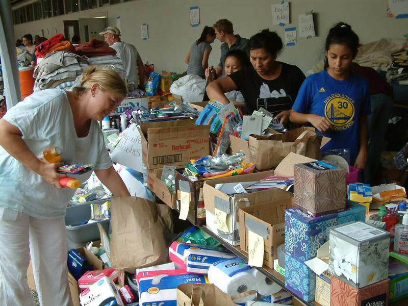 Donations of food, toiletries, blankets and tents poured in alongside evacuees.