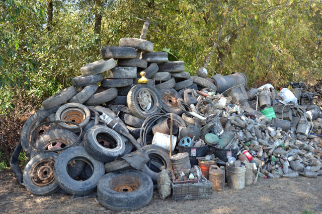 A huge mound of discarded tires and other debris, piled alongside the main channel of the Laguna de Santa Rosa illustrates the severity of the trash pollution that impedes stretches of the mid-county waterway.