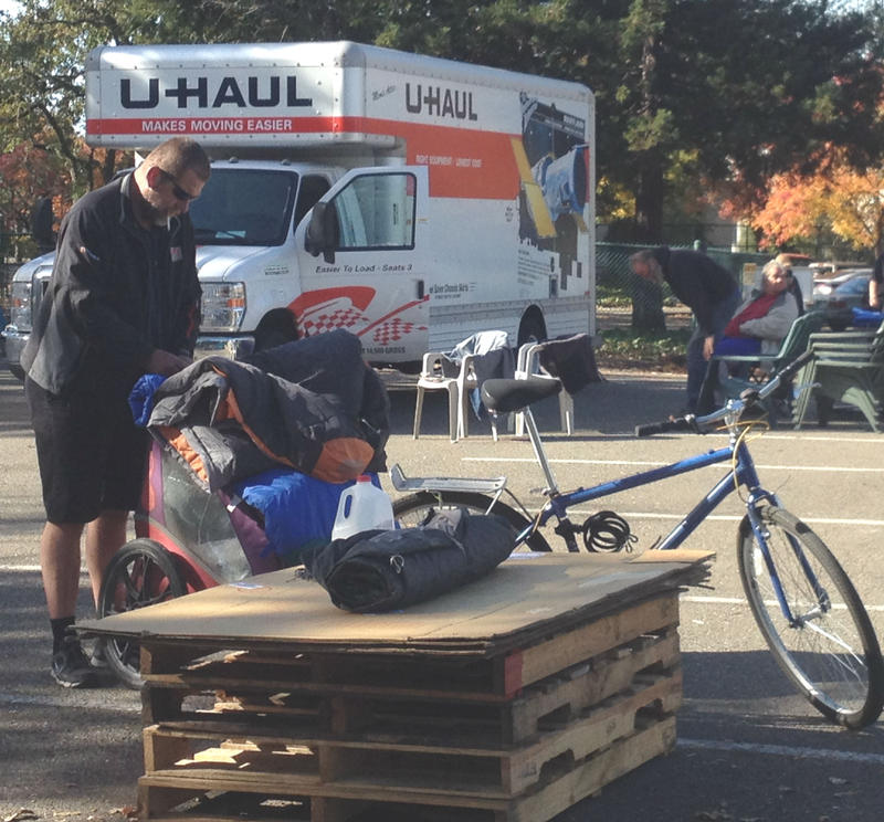 In addition to the truck, residents' cars, trucks, and in this case, even a bicycle were fully loaded as part of the relocation.