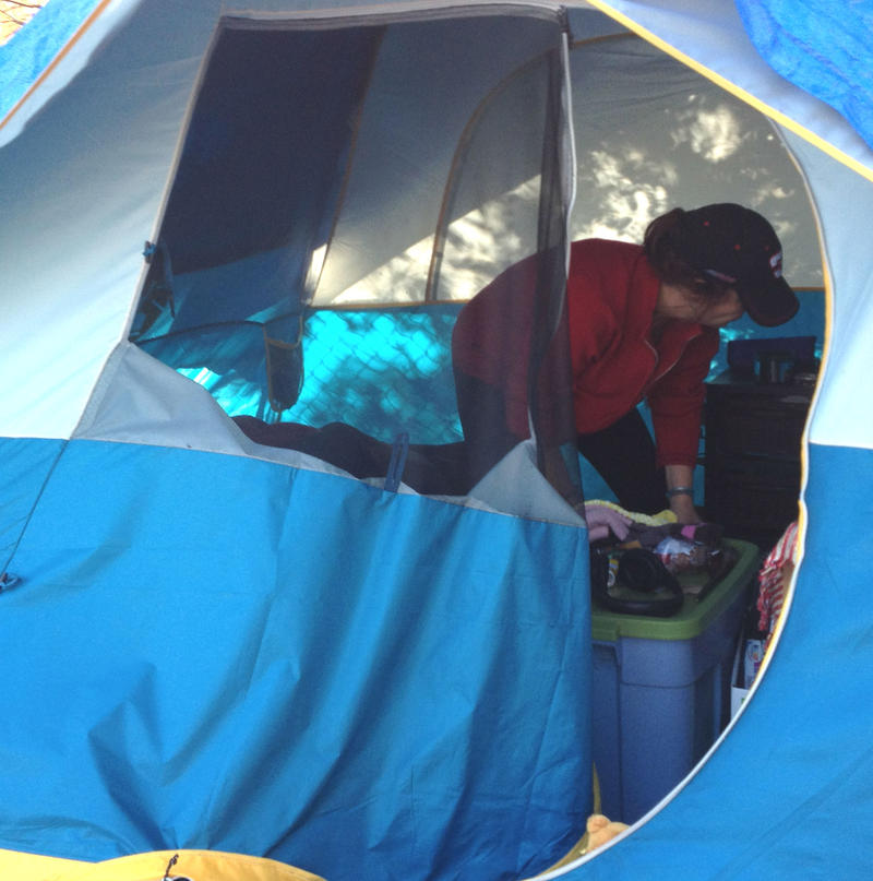 Camp Michela resident Laurie Renee packs up in preparation for Tuesday's relocation.