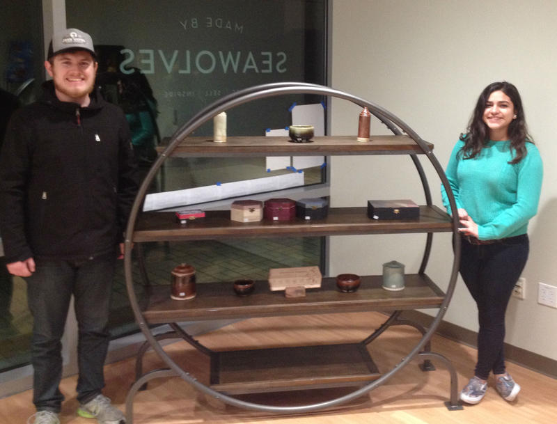 """Justin Nathanson and Marilyn Gonzales show off some of the student-made merchandise in the new 'Made by Seawolves"""" store at SSU."""