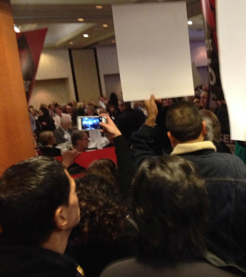 While a small but vocal group of union activists  circulated and chanted inside the Doubletree ballroom, many more added their voices from theadjacent  hallway.