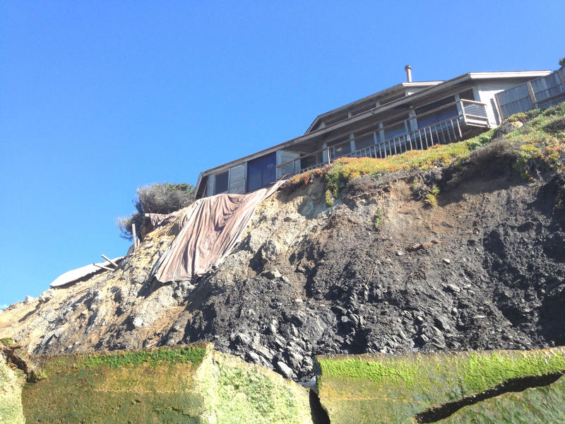 This home, looking out over Gleason Beach, stands above a broken seawall and a slowly eroding cliff. Remnants of a now-demolished former home can be seen at the left.