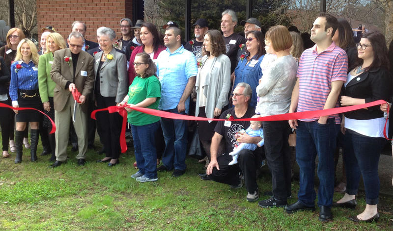 A crowd of donors, clients, family members and case workers was on hand Thursday afternoon at the ribbon cutting and open house for Becoming Independetn's new Autism Integrated Services wing Th