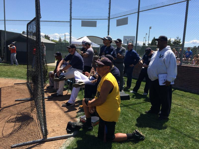 Coaches and managers assess pitchers during the tryout.